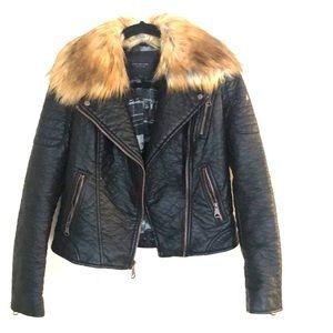 Adorable little black faux leather jacket.